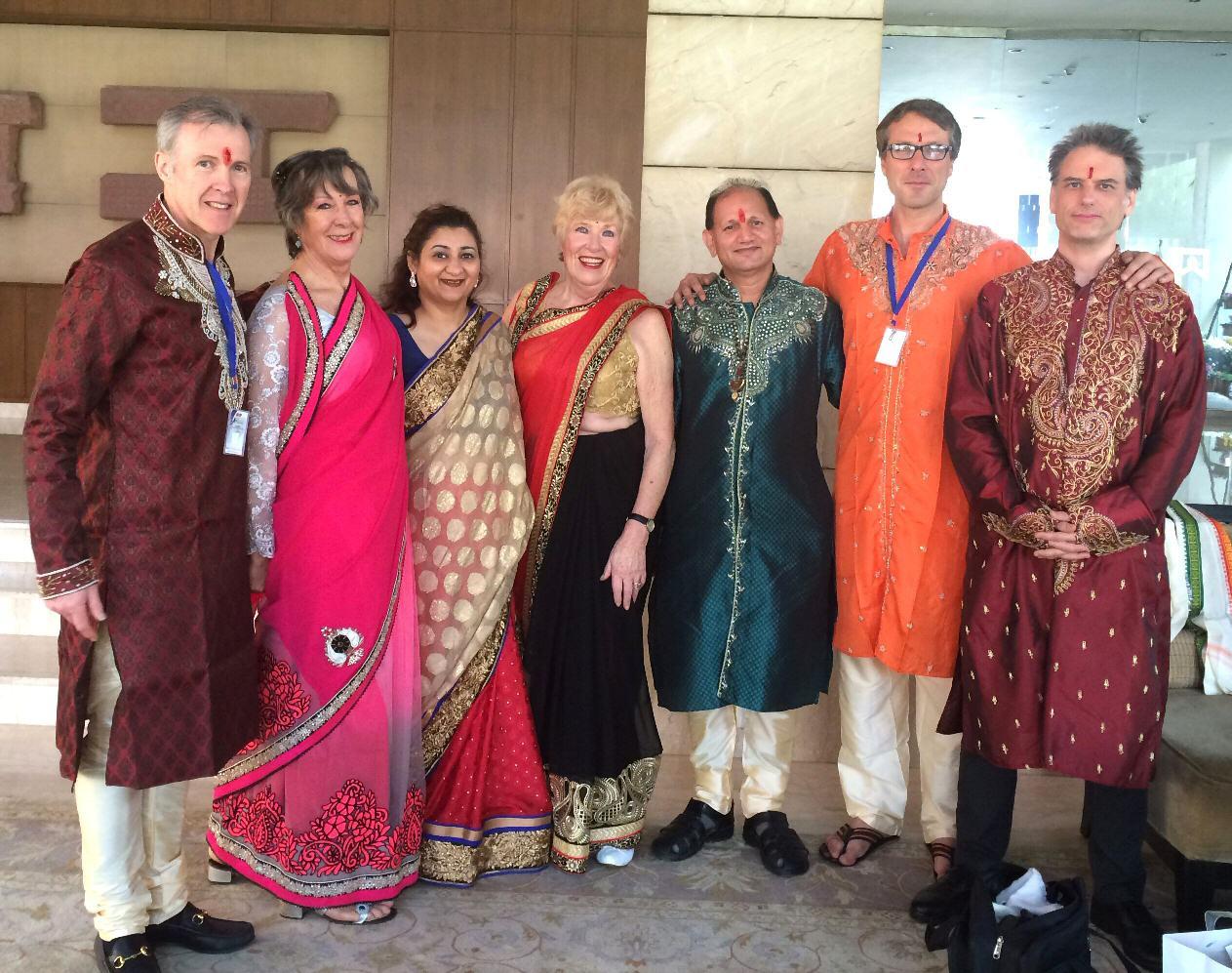 Astrologers dressed in Saris and Sherwanis